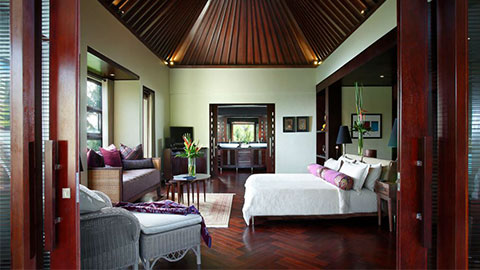 Luxe villas bedroom suite with high ceilings and white linen