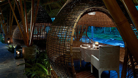 Romantic restaurant on the rivers edge in ubud