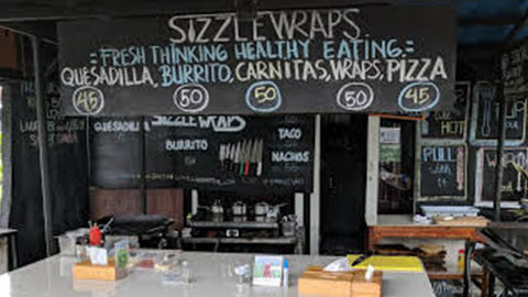 Sizzlewraps sign with price board of set meals