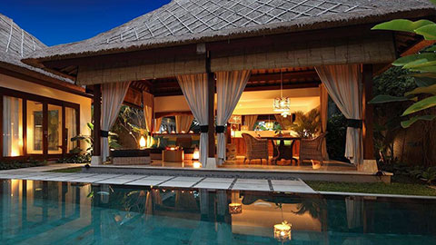 the one boutique villa with pool and patio at night