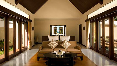 the samaya villa lounge room with cushions neatly arrange on lounge and large bi fold doors
