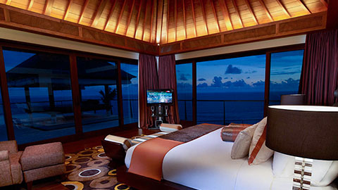 The edge bedroom overlooking the ocean at night