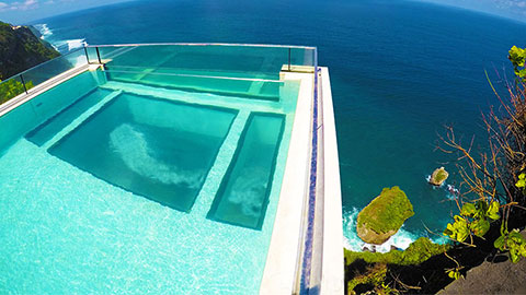 looking down from pool on cliff edge to ocean below at the edge