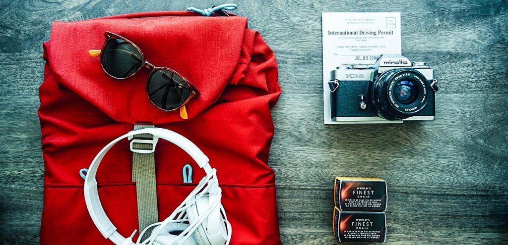 travel safe backpack with items arranged neatly